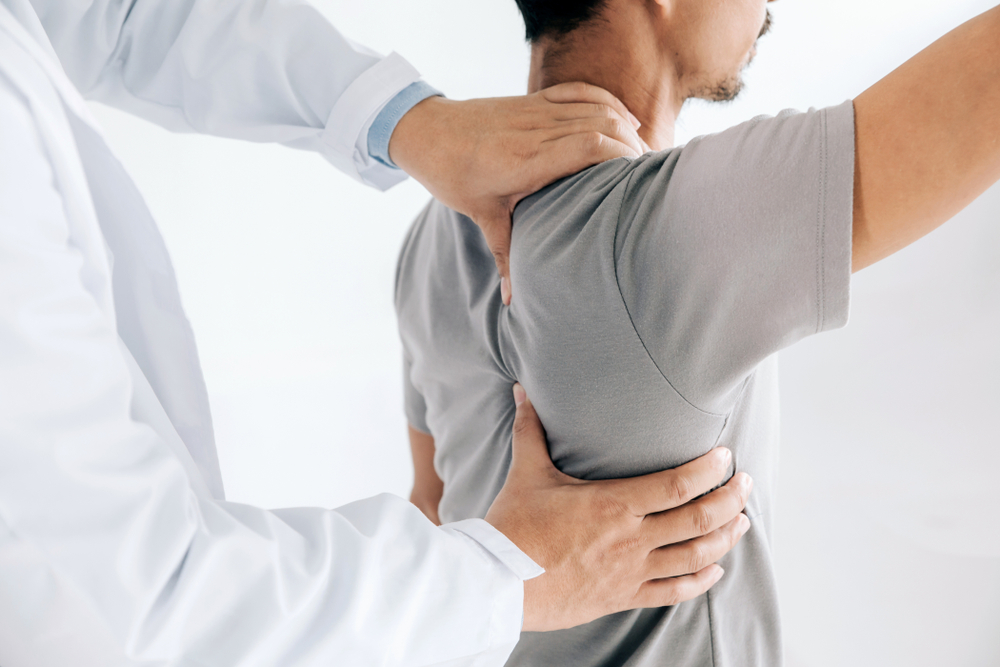 doctor helping patient's range of motion and shoulder pain