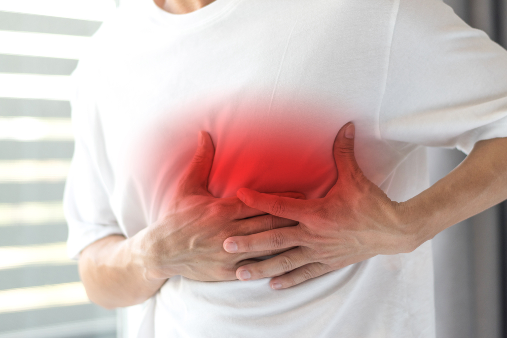 man with shingles pain on side