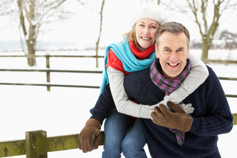 couple with arthritis pain out in snow