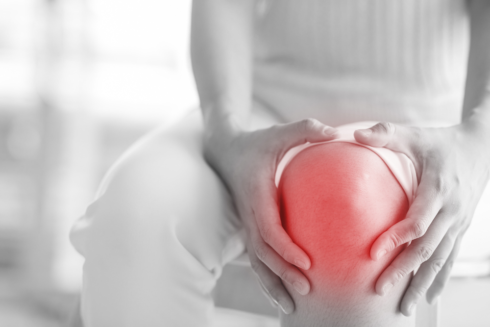 woman knee pain joint injections pain relief