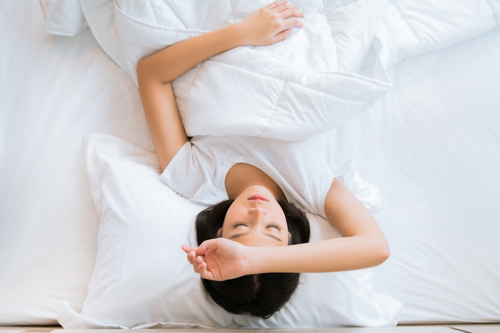 woman in bed with chronic fatigue syndrome